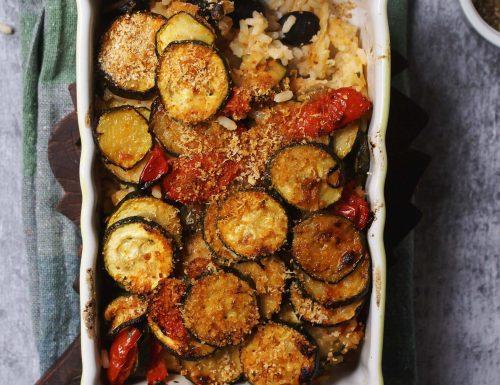 Riso al forno con zucchine e pomodori